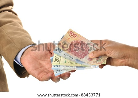 Closeup of woman handing Mexican pesos to man, on white background