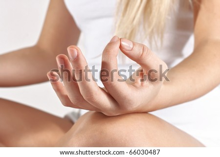 Closeup of woman hands in yoga pose.