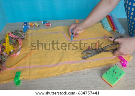 closeup of woman hands sewing yellow cloth outdoors. Woman's Hand Sewing Quilt #684757441