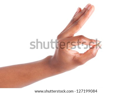 Closeup of woman's hand gesturing - showing ok sign, isolated on white background