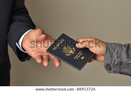 Closeup of woman's hand giving passport to man