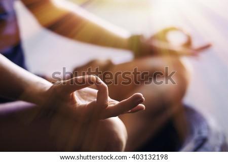 Closeup of woman\'s hands meditating indoors