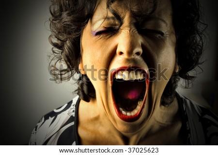 closeup of woman screaming - stock photo
