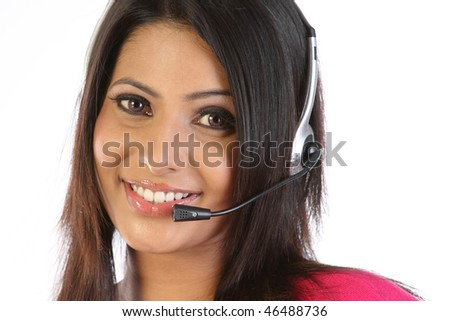 closeup of woman with microphone smiling over a white background