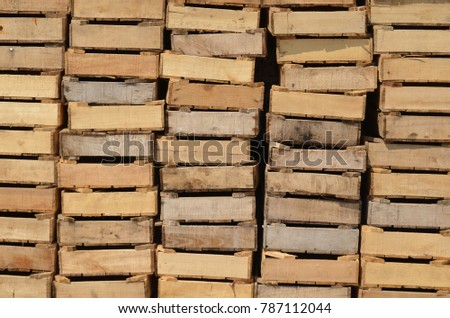 Closeup of wooden produce boxes stacked in a harbour  #787112044