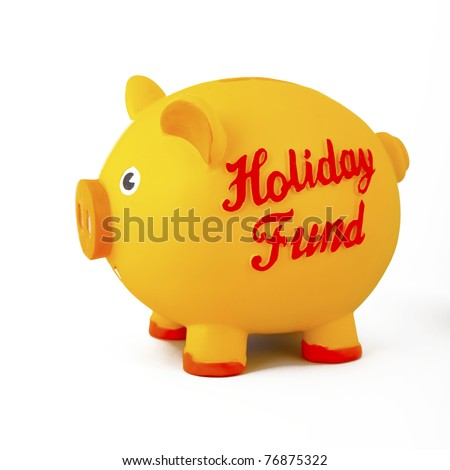 Closeup of yellow piggy bank, holiday/vacation savings, isolated on white.