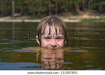 Closeup of young beautiful girl with beautiful smile in water