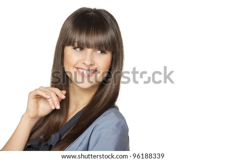 Closeup of young brunette female looking sideways at empty copy space, isolated on white background