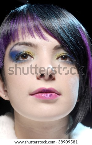 blue and purple makeup. and yellow lue makeup