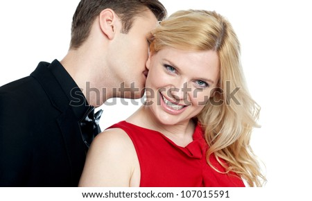 Closeup of young man kissing his lovers neck. All on white background
