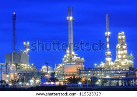 Closeup oil refinery factory at twilight, Chao Phraya river, Thailand