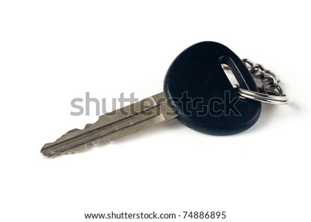 Closeup on a car key on white background