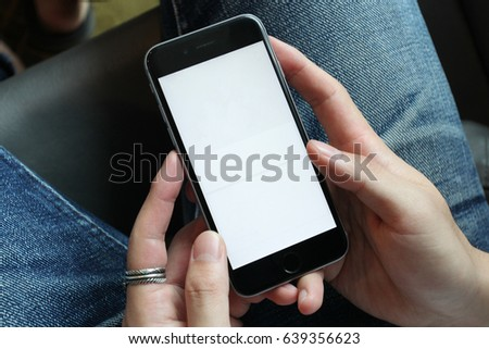 Closeup on a man's hands as he is using a smart phone. #639356623