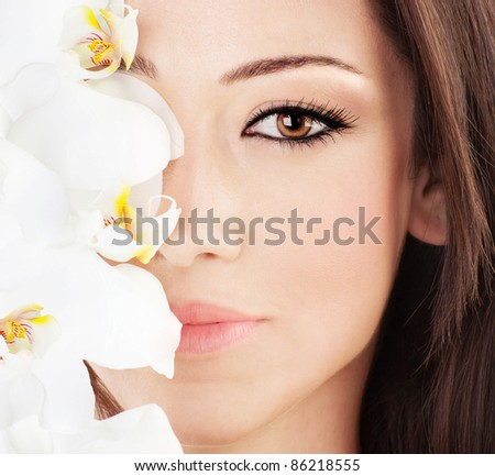 stock photo : Closeup on beautiful face with white orchid flower, ...