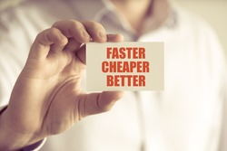 Closeup on businessman holding a card with text FASTER CHEAPER BETTER, business concept image with soft focus background and vintage tone
