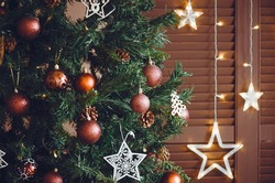 Closeup on christmastree with ornaments and stars
