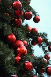 Closeup on christmastree with red ornaments