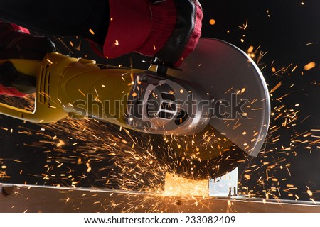 closeup on electric saw and hands of worker with sparks man working with grinder close up on tool sparks fly real situation picture