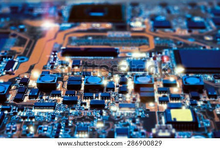 Closeup on electronic board in hardware repair shop, blurred and toned image. Shallow DOF, focus on the middle left field #286900829