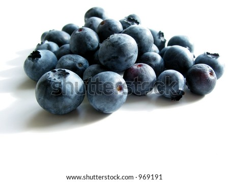 Closeup on fresh blueberries isolated on white background