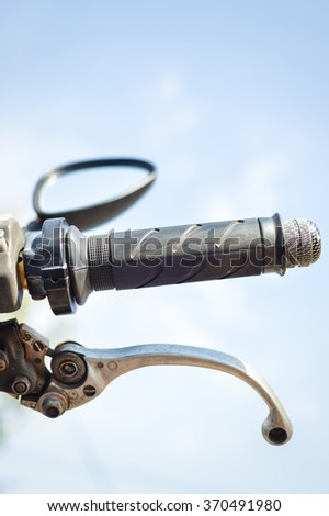 Closeup on handlebar of a motorcycle over sunny outdoors background Foto stock ©