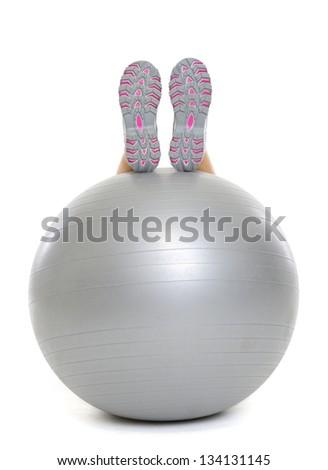 Closeup on leg laying on fitness ball