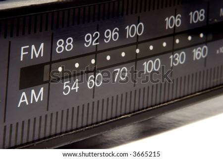 closeup on old AM/FM radio display