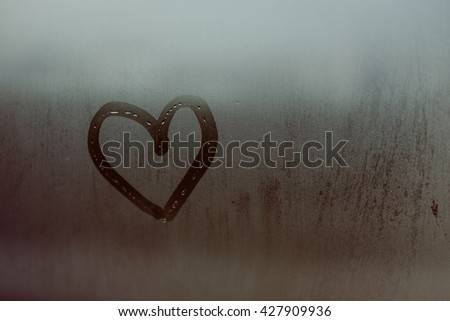 Closeup on painted heart with the foggy window. I love you on Valentine's Day. #427909936