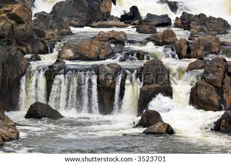 Closeup on Potomac Falls with blue herons