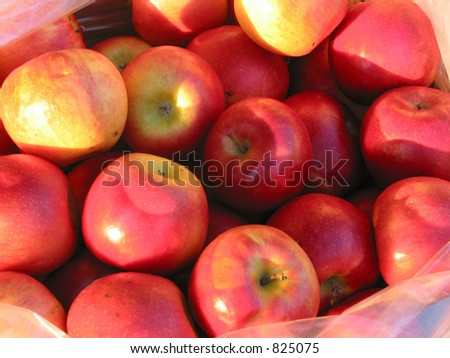 Closeup on red apples in a basket at farmer\'s market