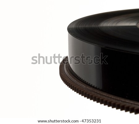 Closeup on reel of black magnetic tape used for backup