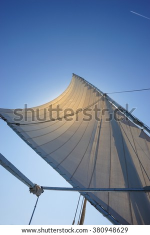 Closeup on sail on blue sky background, active lifestyle,  summer holidays                              #380948629