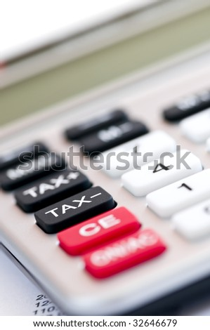 Closeup on tax calculator keypad with red black and white buttons