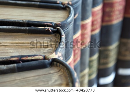 Closeup on top of old legal / law books with blurred backround