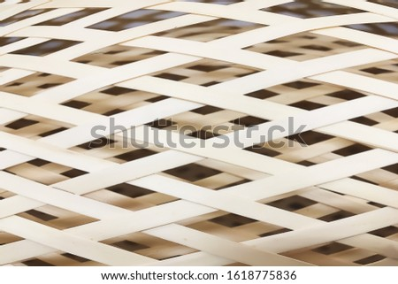 Closeup on two layers of wickerwork craft from pliable bamboo plant of nature materials.Background of natural materials use for manufacture industry.