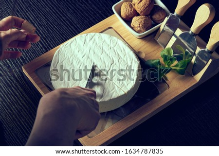 Closeup on woman cutting fresh cheese. Сток-фото ©