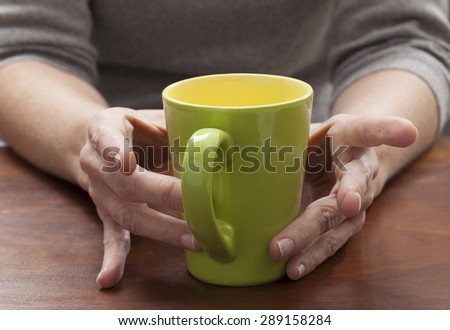 closeup on woman's hands thinking at breakfast with a cup of coffee #289158284