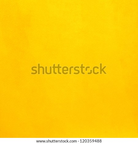 Closeup on yellow leather background.