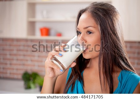 Closeup on young woman drinking milk #484171705