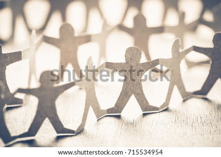 Closeup one of human chain paper, unique person in crowd concept #715534954