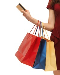 closeup or picture of woman with shopping bags .