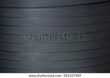 Closeup Packaging Straps pattern - Plastic strapping bands for packaging and fastening cargo.