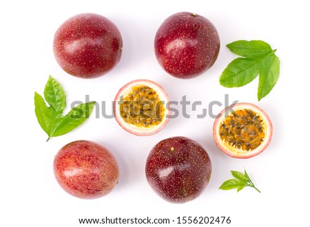 Closeup passionfruit ( maracuya ) or passion fruits and half slice with green leaves isolated on white background. top view. Flat lay.
