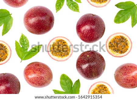Closeup passionfruit ( maracuya, passiflora edulis, Maracuja ) or passion fruits and half slice with green leaves isolated on white background. top view. Flat lay.