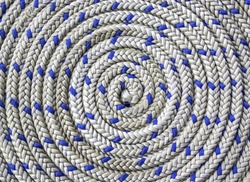 Closeup pattern of circular spirally nautical rope
