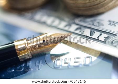 closeup pen, credit card and money