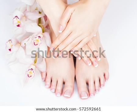 Closeup photo of a female feet at spa salon on pedicure and manicure procedure - Soft focus image Stock photo ©