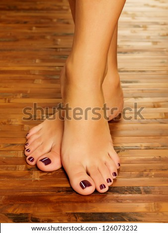 Closeup photo of a female feet at spa salon on pedicure procedure Soft focus image