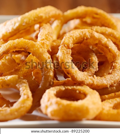 closeup photo of a pile of onion rings
