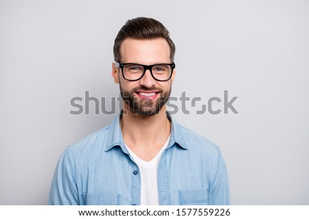 Closeup photo of amazing friendly business guy perfect neat appearance hairstyle young promoted boss chief wear specs casual denim outfit isolated grey color background